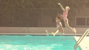 girls jumping in